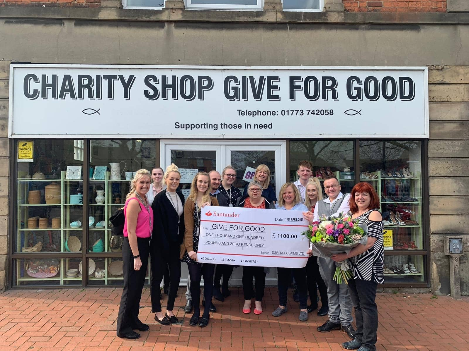 Employees from DSR Tax Claims Ltd present staff at Give for Good with a cheque