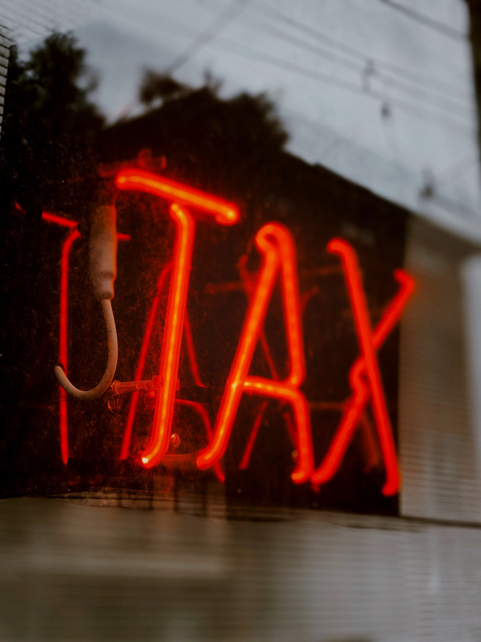 Neon sign reading TAX